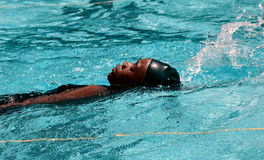 Swimming Lesson. A young woman learning to swim Royalty Free Stock Photography