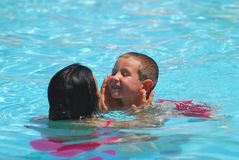 Swimming Lesson One. Lady giving child a swimming lesson Royalty Free Stock Image