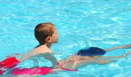 Swimming Lesson Two. Lady giving child a swimming lesson Stock Photography