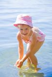 Swimming little girl Stock Photos