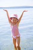 Swimming little girl Stock Photo