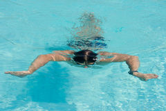 Swimming man. Swimming young man (the breaststroke Royalty Free Stock Photos