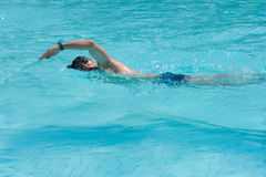 Swimming man. Swimming young man (the crawl style Stock Images