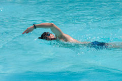 Swimming man. Swimming young man (the crawl Royalty Free Stock Photography