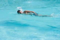 Swimming man Stock Photo