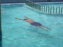 Swimming Man. A man swimming under the water, in a swimming pool Stock Photography