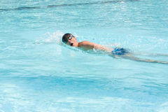 Swimming man Stock Images