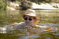 Swimming  man in hat Royalty Free Stock Photo