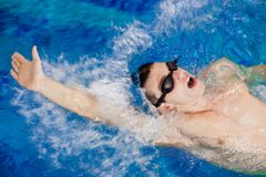 Swimming man Stock Image