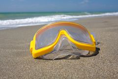 Swimming mask on sea beach Stock Photo