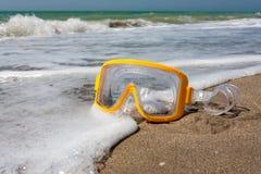 Swimming mask on sea beach Royalty Free Stock Image
