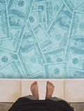 Swimming in money Royalty Free Stock Photography