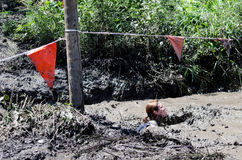 Swimming in mud. A young woman swims in mud at the mudathlon held in northwest  Indiana USA Stock Photos