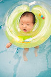 Swimming newborn baby. A baby was born just one week is swimming royalty free stock images