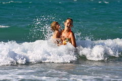 Swimming in the ocean waves stock photos