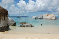 Swimming in paradise. Swimming in turquoise waters with fine white sand and large granite boulders.  The Baths.  British Virgin Islands Stock Photo
