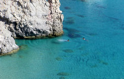 Swimming in paradise. Two men swimming in Milos island, Greece Stock Photography