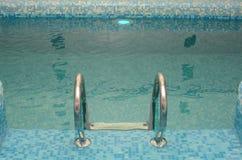 Swimming poll handrail Stock Photo