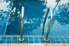 Swimming poll handrail stairs Stock Photos