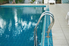 Swimming poll handrail stairs Stock Images