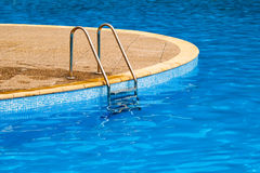 Swimming pool. Steps and blue water Royalty Free Stock Image