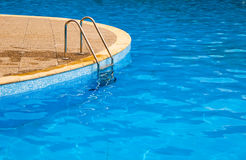 Swimming pool. Steps and blue water royalty free stock images