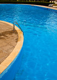 Swimming pool. Steps and blue water Royalty Free Stock Photography