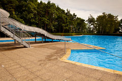 Swimming pool. Steps and blue water royalty free stock photos