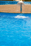 Swimming pool. Steps and blue water Stock Photography