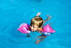 Swimming in the pool Stock Photography