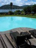 Swimming-pool. A luxury hotel swimming-pool, on background an italian lake. Europe Royalty Free Stock Images