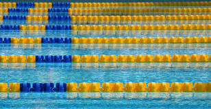 Swimming Pool. The parallel lanes of a swimming pool recede into the background Stock Photos