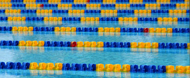Swimming Pool. The parallel lanes of a swimming pool recede into the background Royalty Free Stock Photos
