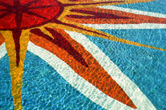 Swimming Pool. This gorgeous sunburst is actually the tiled floor of a swimming pool, resplendent in the midday sun royalty free stock photography