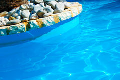 Swimming Pool. With rock paved edging royalty free stock photos