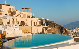 Swimming pool. With view on Santorini, Greece Stock Image