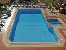 Swimming Pool. A swimming pool in a typical small holiday hotel in Turkey Stock Photos