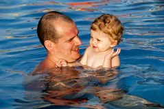 Swimming in the pool Stock Photos