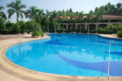 Swimming pool. Sunny summer day large swimming pool in the hotel Royalty Free Stock Image