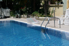 Swimming pool. With stair at hotel close up Stock Image