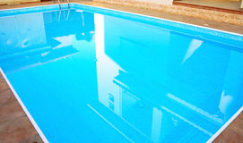 Swimming pool. Blue water in swimming pool Stock Photo