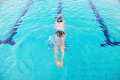 Swimming pool. Young man diving in swimming pool Royalty Free Stock Image