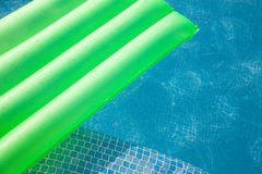 Swimming pool. Abstract of swimming pool and bright green lilo Stock Image