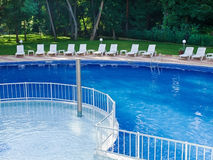 Swimming pool. Spa resort swimming pool in early morning Stock Photography
