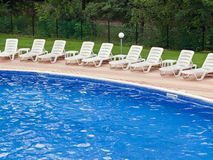 Swimming pool. Spa resort swimming pool and lounge chairs Royalty Free Stock Photography