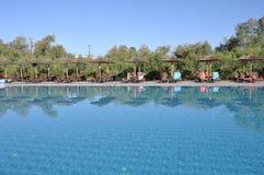 Swimming pool. Gorgeous resort swimming pool with umbrellas during daytime Stock Photos