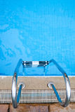 Swimming pool. Part of swimming pool with ladder Stock Photography