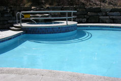 Swimming pool. Part of the swimming pool with hot tub stock photos