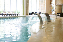 Swimming pool. Luxury swiming pool in the resort hotel Royalty Free Stock Photography