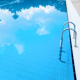 Swimming pool. With cloud's reflections Stock Images